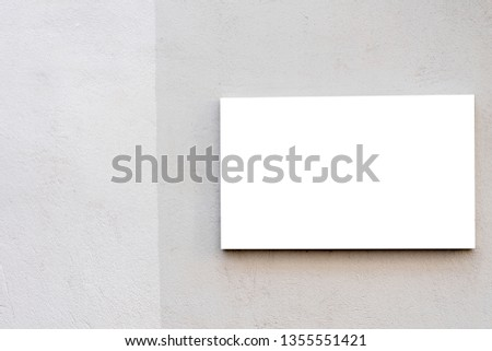 Mock up template. Horizontal blank signboard on the wall outdoors