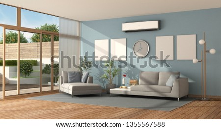Blue living room of a modern villa with sofa ,chaise lounge and air conditioner - 3d rendering #1355567588