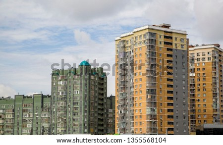 multistory houses in a residential area #1355568104