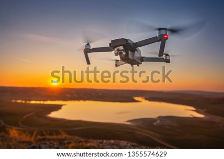 drone on sunset background #1355574629