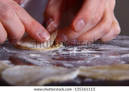 hand made ravioli getting prepared on table #135561113