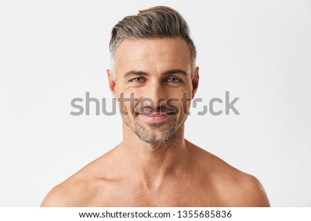 Closeup portrait of european half naked man 30s having bristle smiling at camera isolated over white background #1355685836