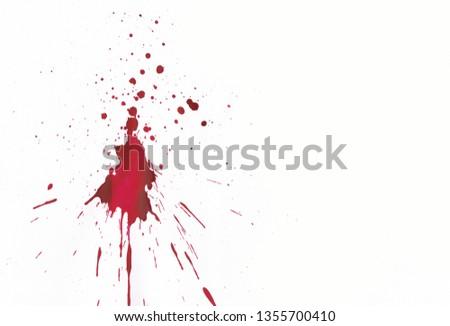 Blood splatters on white background #1355700410