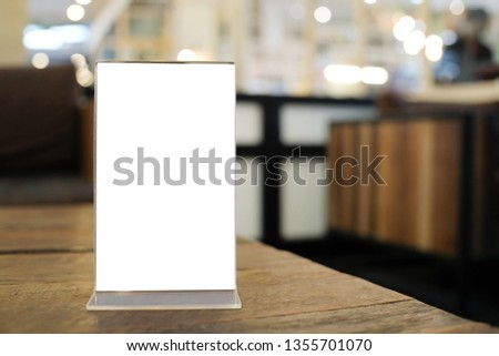 Menu frame space for text marketing promotion standing on wood table in Bar restaurant cafe