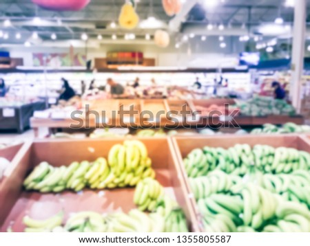 Blurred motion customer shopping for fresh fruits at Asian supermarket in Texas, America. Assortment of tropical fruits on display #1355805587