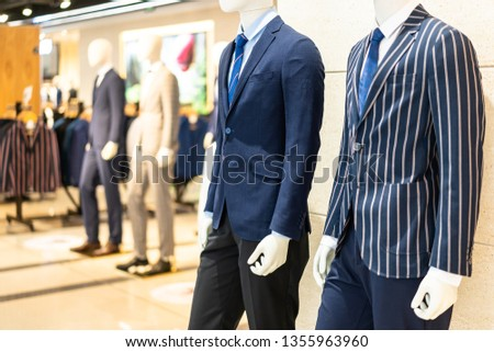 mannequin with suit in shopping mall #1355963960