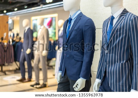mannequin with suit in shopping mall #1355963978