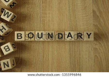 Boundary word from wooden blocks on desk Royalty-Free Stock Photo #1355996846