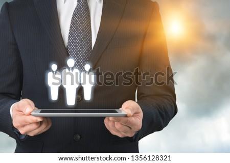 Business man holding opinion leader, team leader, market leader, Leading concepts. #1356128321