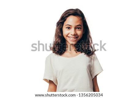 Portrait of young girl on white background #1356205034