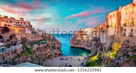 Spectacular spring cityscape of Polignano a Mare town, Puglia region, Italy, Europe. Colorful evening seascape of Adriatic sea. Traveling concept background.