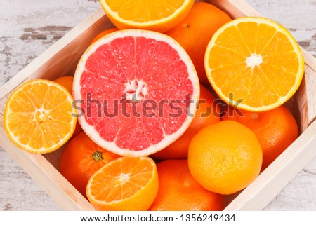 Fresh natural citrus fruits in wooden box. Concept of slimming, diet and healthy nutrition #1356249434