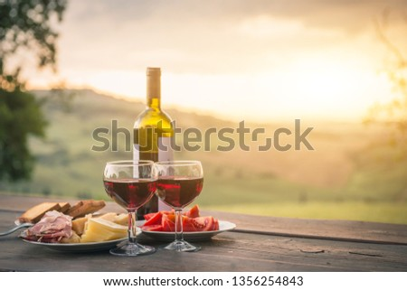still life Red wine ,cheese and prosciutto. Romantic dinner outdoors #1356254843