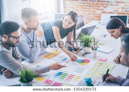 Business people meeting at office and use post it notes to share idea. Brainstorming concept. Sticky note on glass wall. #1356320573