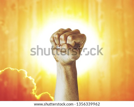 Labor Day photography concept, closeup of the raised fist of a young man #1356339962