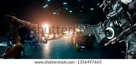 Robotics automatic arms machine of making movie and TV commercial in studio. Camera of movie. Innovation and technology of movie industry with monitoring system software. Film crew team in set. Royalty-Free Stock Photo #1356497663