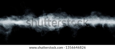 Panoramic view of the abstract fog or smoke move on black background. White cloudiness, mist or smog background.  Royalty-Free Stock Photo #1356646826