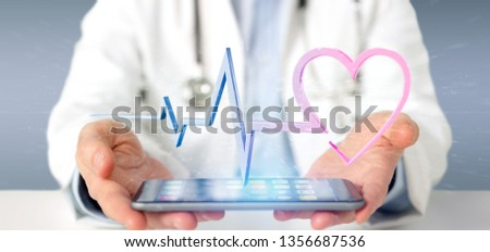 View of a Doctor holding a 3d rendering medical heart curve  #1356687536