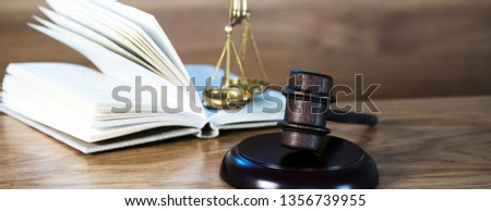 Law and justice concept image. Brown wooden background #1356739955