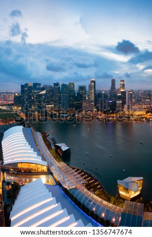 Singapore cityscape at dusk. Landscape of Singapore business building around Marina bay. Modern high building in business district area at twilight. #1356747674