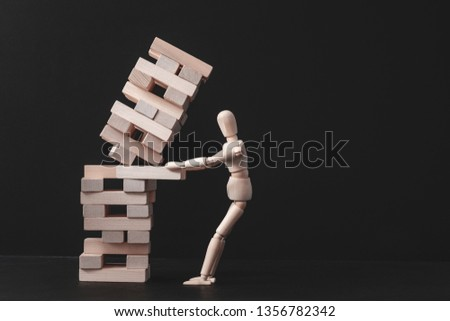 Business project. Strategy mistake. Risk and failure. Falling tower stack. Conceptual articulated mannequin composition. #1356782342