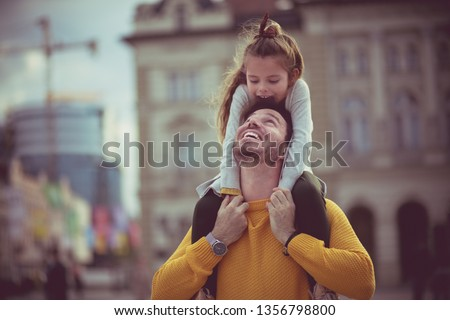 Daughter and father love. Father and daughter in the city. #1356798800