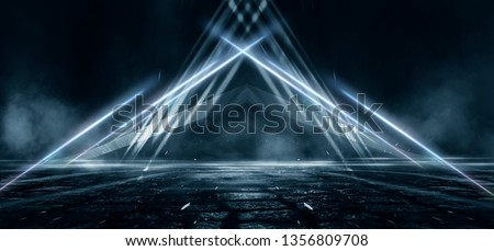 Product showcase spotlight background. Clean photography studio. Abstract blue background with rays of neon light, spotlight, reflection on the asphalt. #1356809708