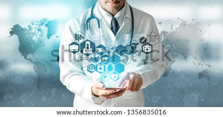 Health Insurance Concept - Doctor in hospital with health insurance related icon graphic interface showing healthcare people, money planning, risk management, medical treatment and coverage benefit. #1356835016