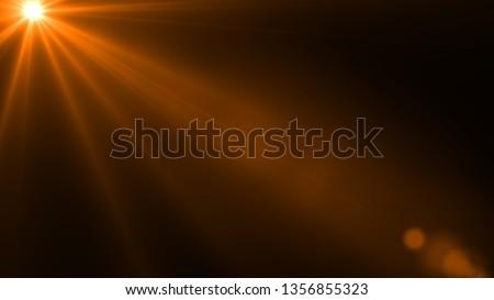 Sun rays light isolated on the black background for overlay design ( screen blending mode layer) #1356855323