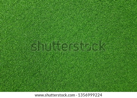 Surface of fake green grass for background or backdrop. #1356999224