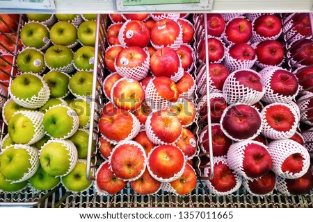 Imported apples in the supermarket comes with styrofoam fruit net. Environmentalism & Plastic Awareness. #1357011665