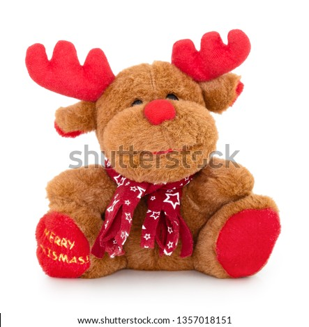 """Smiling christmas reindeer plush toy with """"merry christmas!"""" writing on his foot. Isolated on white background with natural shadow. Xmas deer soft baby toy. Christmas buck with muffler on white bg. #1357018151"""