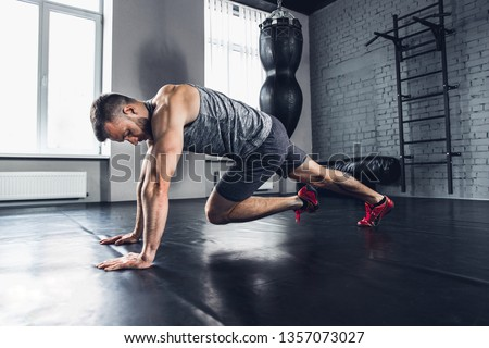 Run as you breath. The athlete trains hard his lower and upper body in the gym, doing exercises for calves and glutes. Push-up and press-up, work out. Fitness, healthy life and self-control concept. #1357073027