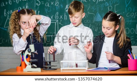 childrens day. students doing biology experiments with microscope. Little kids learning chemistry in school lab. Chemistry. Back to school. Little children at school lesson. New ideas for medicine. #1357074620