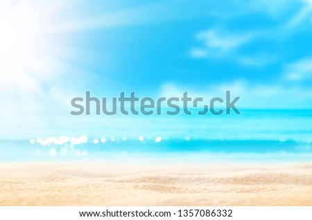 Summer background. Sea sand sun. Blur tropical beach with bokeh light wave abstract . Copy space of outdoor holiday vacation and travel adventure concept. Vintage tone filter effect color style. #1357086332