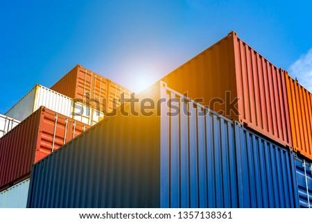 Industrial Containers box from Cargo freight ship for import export concept. Royalty-Free Stock Photo #1357138361