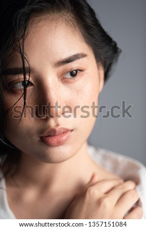 Shooting studio portrait of young Asian Thai woman with white shirt on white background. Relax and mordern concept. #1357151084