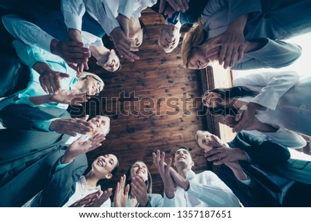 Close up low angle view photo diversity members business people stand circle she her he him his together best brigade show appreciation clap hands arms project power formal wear jackets shirts #1357187651