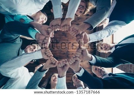 Close up low angle view photo members business people circle she her he him his hold hands arms fists together celebrate project prize nomination power inspiration dressed formal wear jackets shirts #1357187666