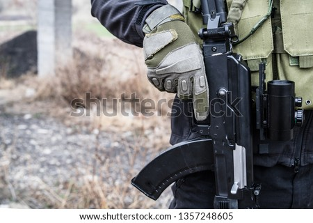 SWAT anti terrorist soldier special police force holding the rifle on the mission battle #1357248605