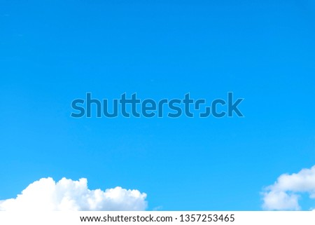 Blue sky background with tiny clouds #1357253465