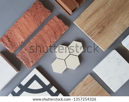 samples of material, wood , on concrete table.Interior design select material for idea. Decoration idea concept vintage material.   Royalty-Free Stock Photo #1357254326