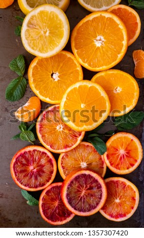 An array of colorful citrus fruits arranged in flower and rainbow pattern #1357307420