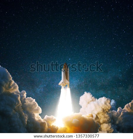 Spacecraft flies up into the starry sky. Rocket with smoke flies into space. Space Shuttle #1357330577
