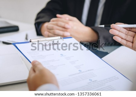 Employer arriving for a job interview, businessman listen to candidate answers explaining about his profile and colloquy dream job, manager sitting in job Interview talking in office. #1357336061