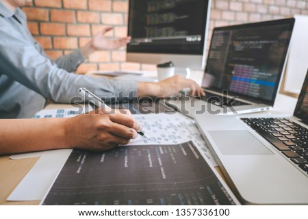 Professional Developer programmer cooperation meeting and brainstorming and programming in website working a software outsourcing and coding technology, writing codes and database. #1357336100