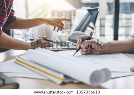Construction and structure concept of Engineer or architect meeting for project working with partner and engineering tools on model building and blueprint in working site. #1357336610