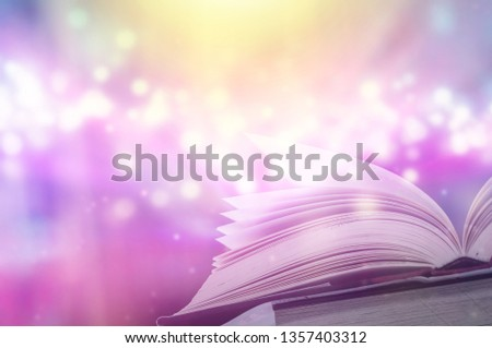 Stack of books in the library and blur bookshelf background  #1357403312
