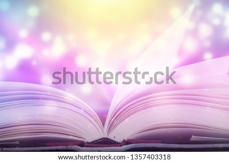Stack of books in the library and blur bookshelf background  #1357403318