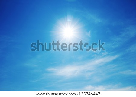The sun shines bright in the daytime in summer. Blue sky and clouds. #135746447
